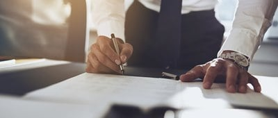 Man signing a commercial lease