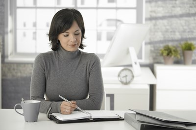 Business woman working on start-up checklist